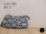 Pleated pouch with zip